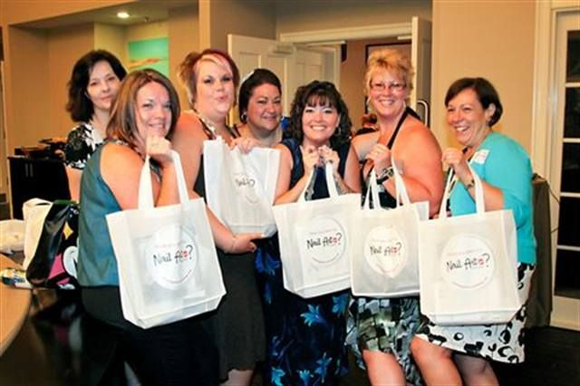 <p>Party-goers show off their goodie bags.</p>