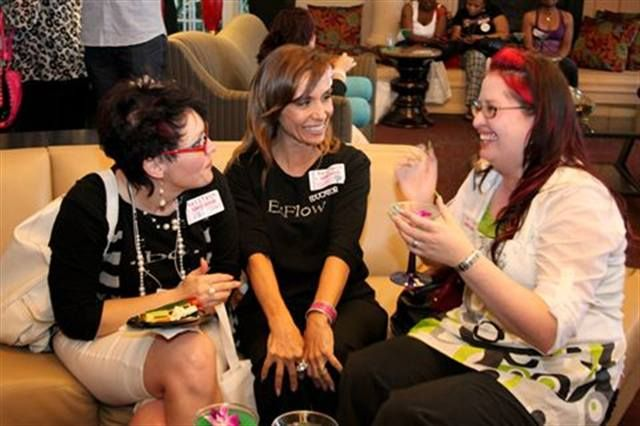 <p>Sara Stokes, Silvy Rosario, and Sandy Combs share stories as the party gets started.</p>