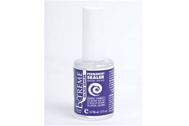 """<p>Spooky Glowers</p> <p><strong>Backscratchers&rsquo;</strong> Extreme Glaze Permanent Sealer not only adds mesmerizing shine but makes nails glow under the black light. The sealer works overtime to keep nails from chipping, cracking, and peeling. <br /><br /><a href=""""http://www.backscratchers.com"""">www.backscratchers.com</a></p>"""