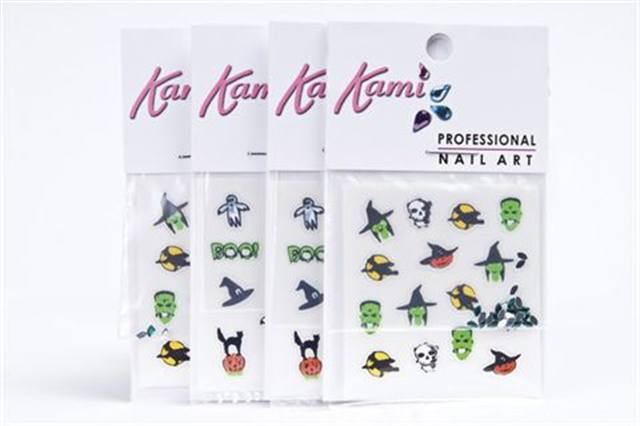 """<p><strong>Kami&rsquo;s</strong> Halloween Nail Art Decals are a cute way to add a little spook and sparkle to your nails for October. Included in each pack are 24 acrylic rhinestones and 15 pre-adhesive decals in fun shapes like ghosts and witches hats. <br /><br /><a href=""""http://www.innovative-beauty.com"""">www.innovative-beauty.com</a></p>"""