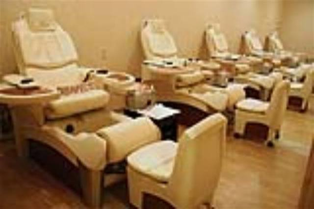 """At Roula's Nail Spa in Houston customers are greeted by a warm and relaxing pedicure area with a little something extra: there is a """"disinfected"""" sign on each pedicure spa, reassuring clients that the chair has been cleaned since the last client."""