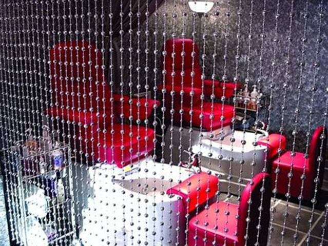This curtain of silver beads contributes to the glamour at Glam! Nails and More in Elmhurst, Ill.