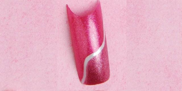 <p><strong>Split Decision </strong></p> <p>Martin used pink and white polish to hand-paint this abstract design. </p>