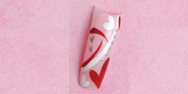 <p><strong>True Love </strong></p> <p>Using pink, white, and red polish, Muñoz then added silver rhinestones for an eye-catching touch. </p>