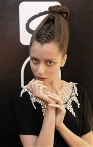 <p>At Rosemount Australian Fashion Week 2010, designer Gail Sorranda requested that nails appear mannequin-like, so CND stylists painted long almond-shaped nails with Putty, a creamy flesh tone. <em>(Photo courtesy of Six 6 Photography, courtesy of Pacific Nail &amp; Beauty Australia)</em></p>