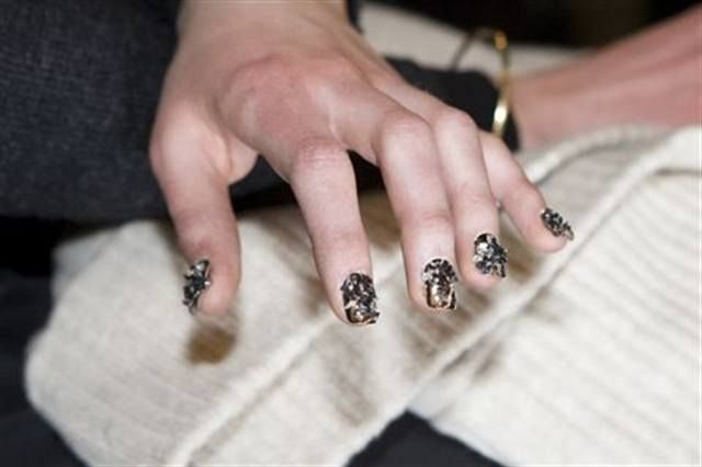"<p align=""left"">Designers Carly Cushnie and Michelle Ochs collaborated with nail artist Pattie Yankee to create a gritty, animalistic texture for the nails. The look featured Dashing Diva Chrome Press-On Nails with an appliqu&eacute; of crushed glass glitter in black and silver. <em>(Photography by Eric Yu)</em></p>"