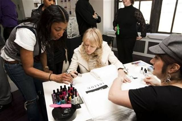 <p>Ginger Johnson (left), co-creator of Ginger + Liz Colour Collection nail lacquer) helps Joanna Coles, editor-in-chief of <em>Marie Claire</em> magazine, pick out a color for her manicure with nail tech Ann Marie Walts at The Future of Fashion retreat. <em>(Photography by Mat Szwajkos)</em></p>