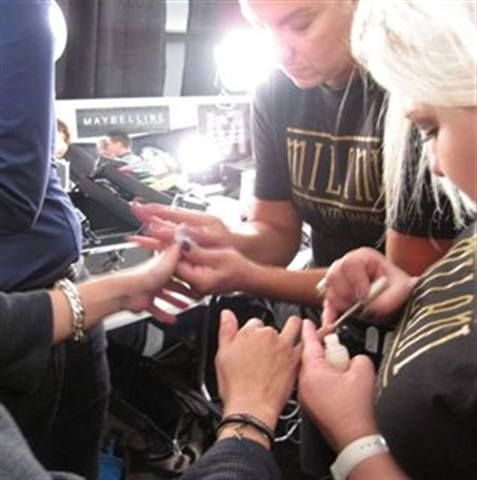 <p>The Milani team polishes models&rsquo; nails at the Charlotte Ronson show.</p>