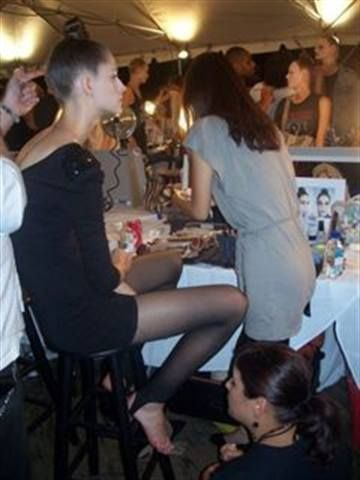 """<p style=""""text-align: left;"""" align=""""left"""">OPI manicurist Renee Meyers works on models backstage at the Marc Jacobs&rsquo; show.</p>"""