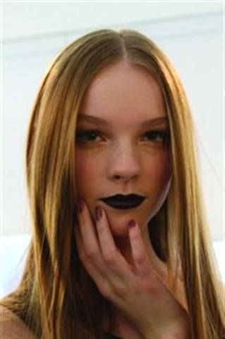 <p>Zoya&rsquo;s Jackie Saulsbery applied polish color Charity, a muted mauve, to complement the plum limps and moody palette of the Peter Som show. <em>(Photography by Anna Thiessen)</em></p>