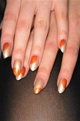 """<p align=""""left"""">Half of the models at the Diego Binetti show had nails that mimicked a sunrise, which was created with CND&rsquo;s Studio White, Ivory Coast, and Electric Orange; the other half&rsquo;s nails represented &ldquo;Thai nights,&rdquo; featuring CND&rsquo;s&nbsp; Inkwell, Ice Blue Shimmer, and rhinestones.</p> <p><em>Photo courtesy of CND</em></p>"""