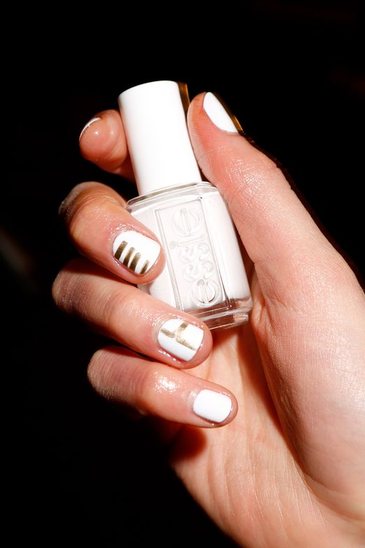 <p>Rita Remark for essie created monogram nail designs for both male and female models at Baja East</p>