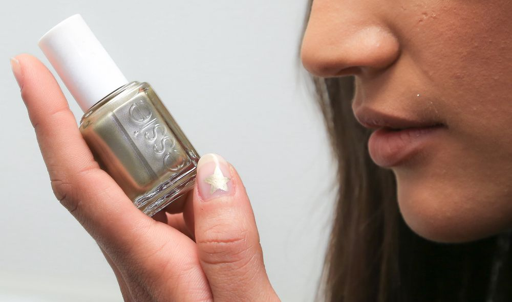 <p>Saunders used Good as Gold to draw a star on the thumb over a coat of Essie Mademoiselle at Jenny Packham</p>