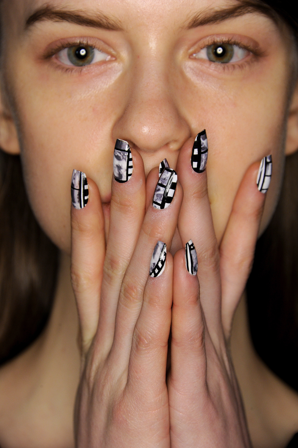 <p>Nails were inspired by 35 mm film at CND for Opening Ceremony.</p>