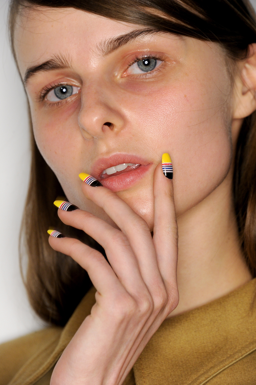 <p>Paying homage to photography, CND artists used the Kodak color palette on nails.</p>