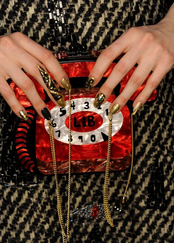 <p>An artistic clash of texture and color made for nail fashion that popped on the Libertine runway from CND.</p>