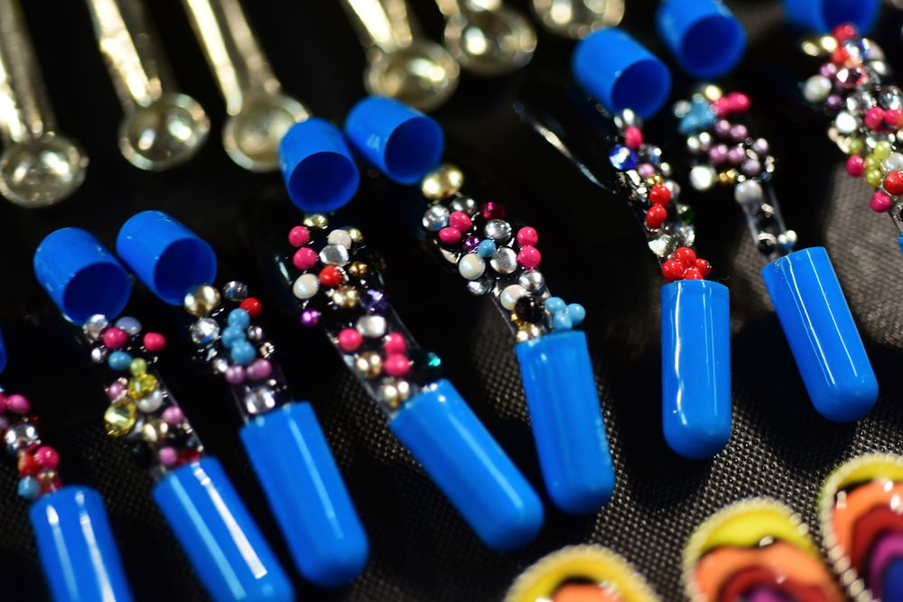 <p>In their seventh collaboration with Johnson Hartig, CND complemented Libertine's daring punk couture looks with edgy nails featuring crystal designs, safety pins, and hand-sculpted bird skulls. Getty for CND.</p>