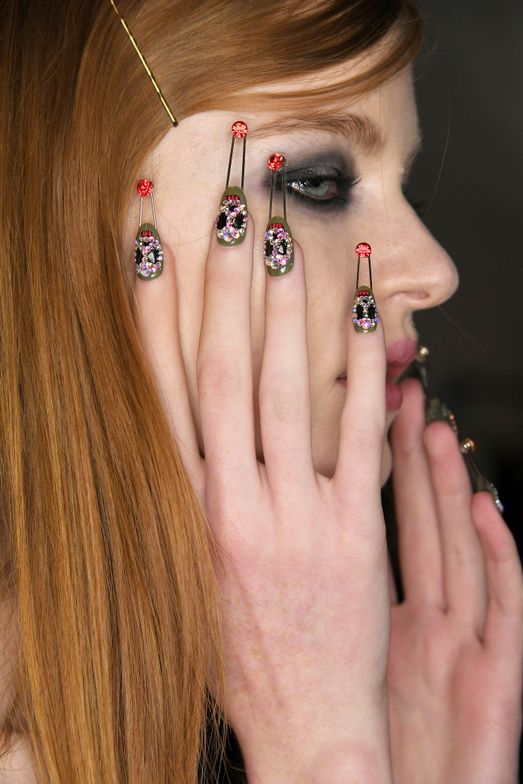 <p>Pave Swarovski crystals were mosaicked into emoji-like designs, including smiley faces, skulls, and dollar signs. Getty for CND.</p>