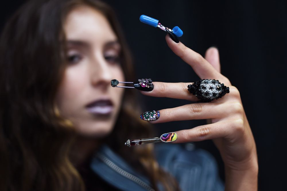 <p>Paraphernalia including tiny spoons and pill capsules spilling out a 'dose of fabulousness' with blade-like embellishments. Getty for CND.</p>