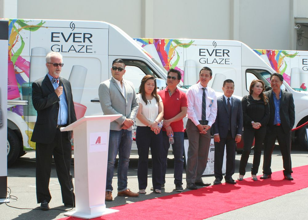 <p>Mark Moesta, AII VP of sales with the three distributor honorees</p>