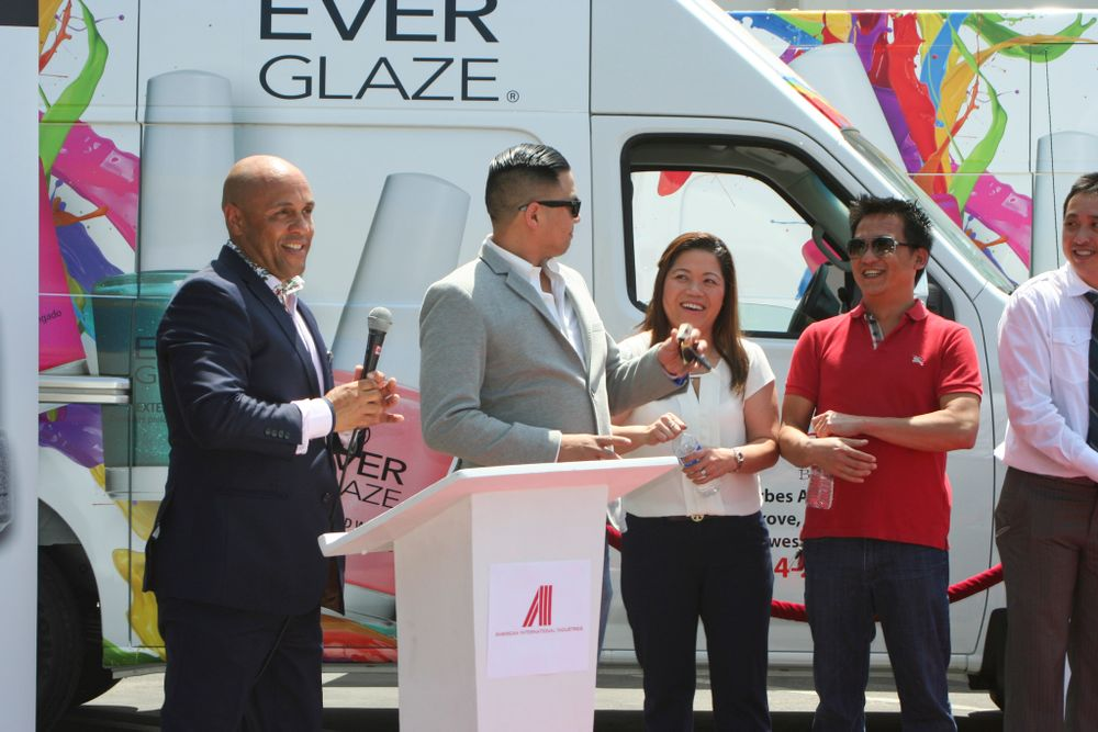 <p>Beauty Zone's Don Le showing off the keys to the company's new van</p>