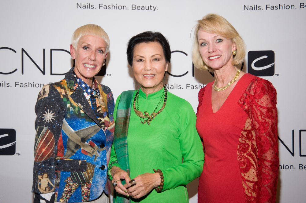 <p>Vietnamese-American actress Kieu Chinh (center) poses with CND's Jan Arnold (left) and BCL President Lynelle Lynch (right) at the BCL CND Tippi Hedren Nail Scholarship Program donor reception.<em> Image courtesy of CND.</em></p>