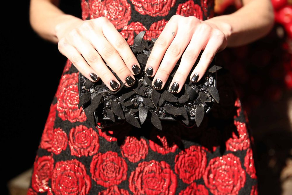 <p>Miss Pop Nails created dark, gold accent nails for the fairy tale-inspired Alice + Olivia show. She used Essie's Black Licorice and dotted Good as Gold on top of it.</p>
