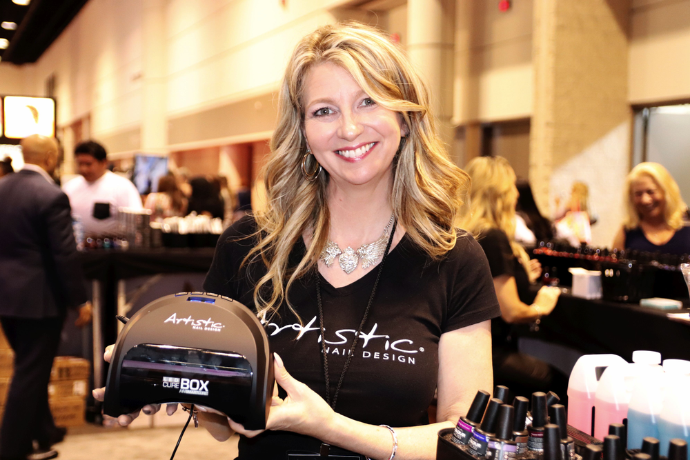 <p>Mary Ore of Artistic shows off the SafeCure LED Light.</p>