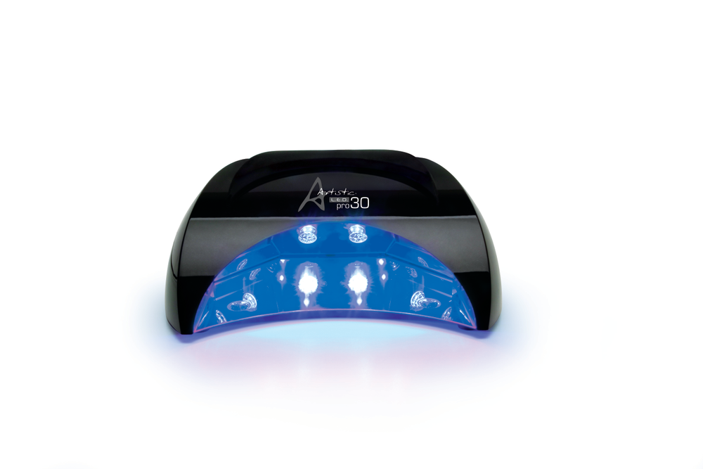 """<p><a href=""""http://artisticnaildesign.com/"""">Artistic</a> Nail Design&rsquo;s Pro 30 LED light cures all five fingers simultaneously with even coverage on every angle of the nail. Eight diamond reflectors maximize the LED power to expedite cure time, eliminating 15-20 minutes of a traditional UV salon service. An auto hand sensor automatically comes on to a preset time when the hand is placed into the light. Multiple cure settings include 10, 20, 30, and 40 seconds. In between services nail techs can clean the light by removing the tray and sanitizing it.</p>"""