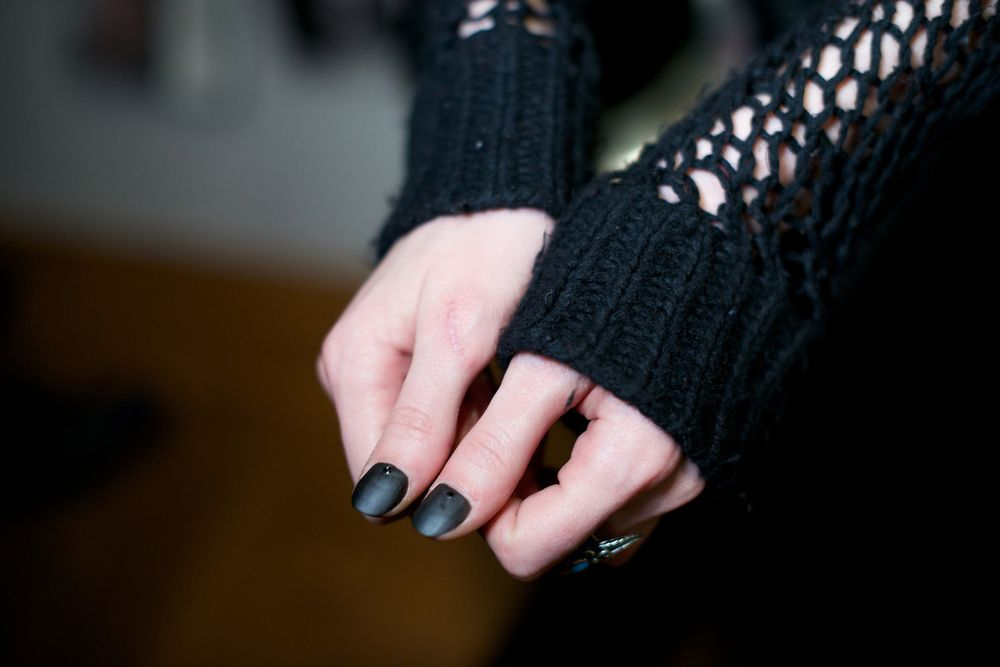 <p>Thumbs for the Assembly show were polished in OPI's black satin-finish lacquer 4 in the Morning. Image courtesy of OPI and Steve Gong.</p>