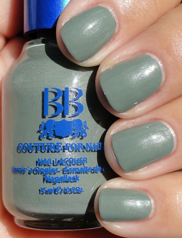 <p><strong>BB Couture for Nails</strong> nail lacquer in Shaded Ash is a greyed out green with silver shimmer.</p>