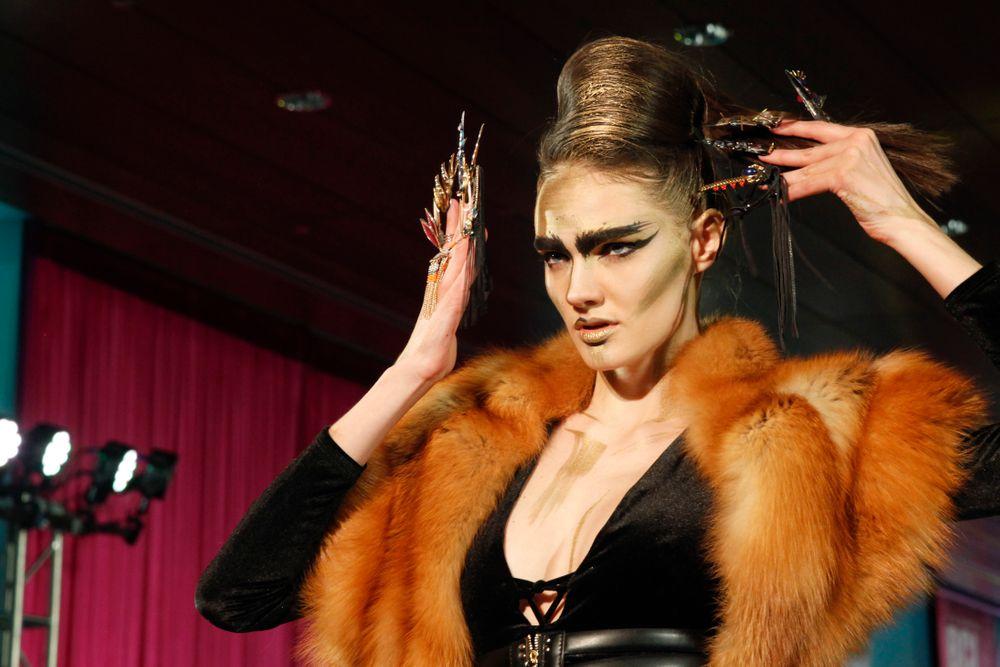 <p>Winnie Huang's model on the runway</p>