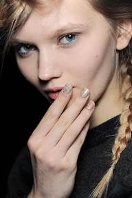 <p>Butter LONDON Global Color Ambassador Katie Jane Hughes and her team created 675 nails with no two alike for the Creatures of the Wind show. Hughes water marbled nails then applied Trallop as the base for half of the models and Teddy Girl for the other half. Photo courtesy of butter LONDON.</p>