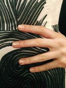 <p>Butter LONDON's Patent Gel Top &amp; Tails kept nails at Lela Rose chip-free. A diagonal stripe of Alabaster Gaze (available April 2014) completed the look. Photo courtesy of butter LONDON.</p>