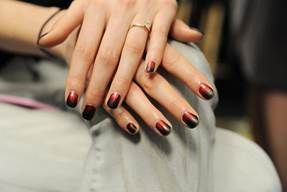 <p>Butter London's Union Jack Black&nbsp; was matted for Nicole Miller's show. A striping brush dipped in Knees Up created a feather of flame-like design along the nail. Photo courtesy of butter LONDON.</p>
