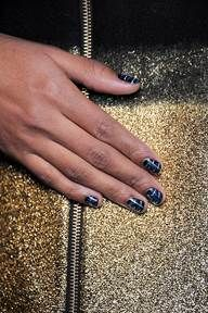 <p>At ICB X Prabal Gurung, butter LONDON Union Jack Black served as the foundation for the nails. Katie Jane Hughes then created a tweed effect using a striper brush and layering Billy No Mates, Stag Do, Blagger, British Racing Green, and Pearly Queen horizontally and vertically. Photo courtesy of butter LONDON.</p>