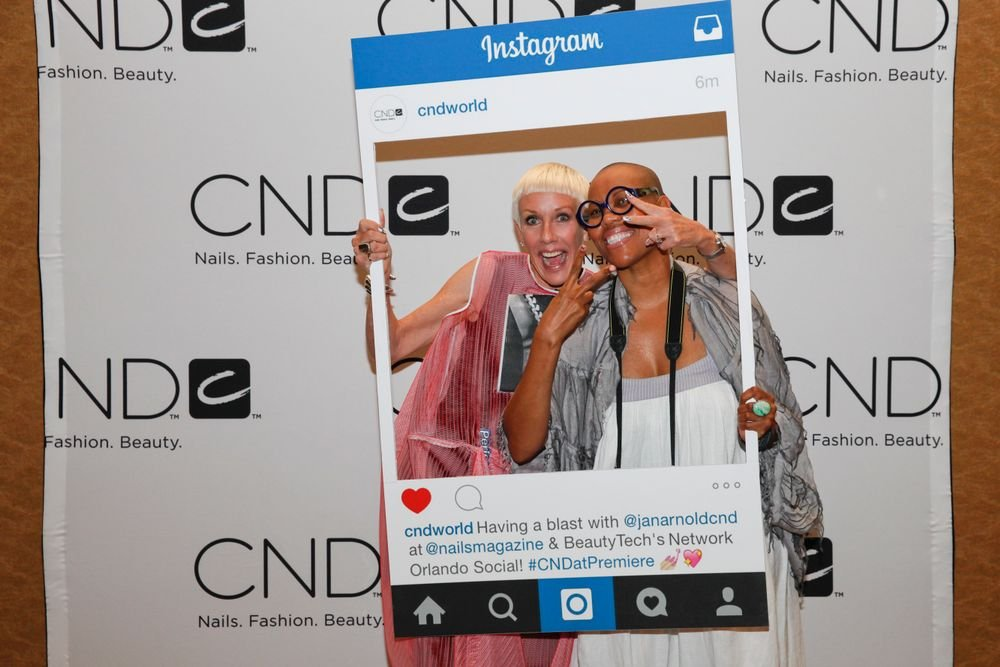 <p>CND's Jan Arnold and Maisie Dunbar at CND's photo booth</p>