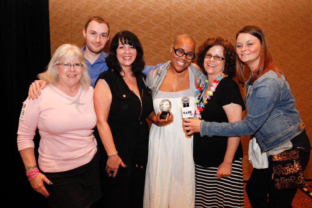 <p>Team Nail Talk Radio giving the Vicki Peters Aaamazing Nail Tech Award to Maisie Dunbar.</p>