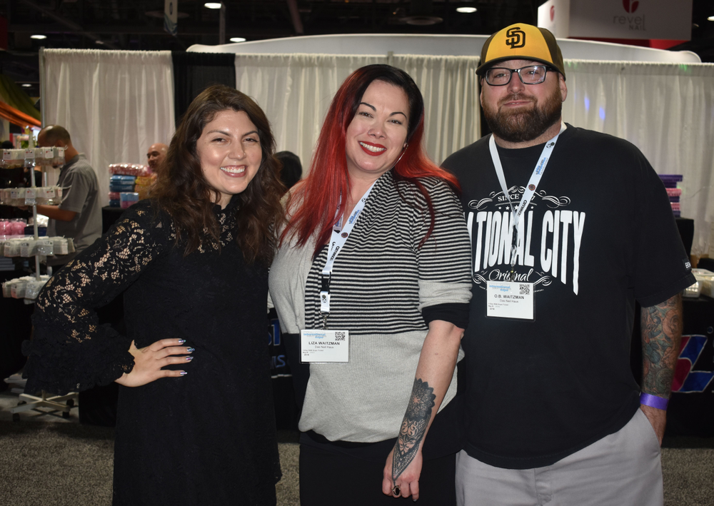 """<p>Executive Editor Beth Livesay and NTNA competitor Liza Waitzman (<a href=""""https://www.instagram.com/dasnailhaus/"""">@dasnailhaus</a>) and her husband</p>"""