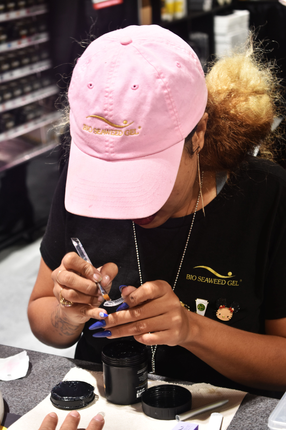 <p>An educator works on a design at the Bio Seaweed Gel booth</p>