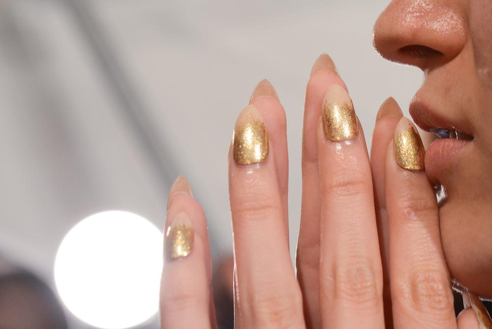<p>China Glaze partnered with Michael Costello to create a glamorous gold manicure. Photo courtesy of Matthew Carasella/SocialShutterbug.com.&nbsp;</p>