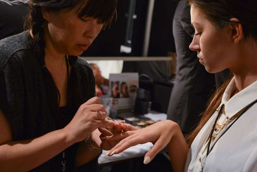 <p>Lead manicurist Casey Herman helped bring the China Glaze tips to fruition at Michael Costello.&nbsp;Photo courtesy of Matthew Carasella/SocialShutterbug.com.&nbsp;</p>