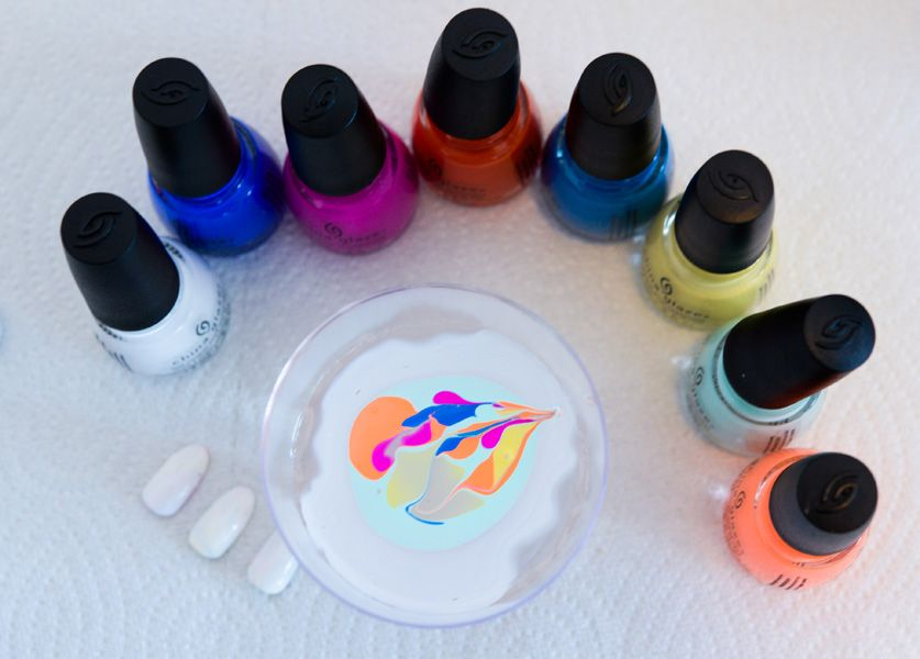 <p>Herman created different color combinations using a mix of new and core China Glaze shades including Pop the Trunk,Sun of a Peach,&nbsp;Are You Jelly?&nbsp;I Sea the Point,Sun Upon My Skin,&nbsp;At Vase Value,&nbsp;White on White, and Sky-High Top. Photo courtesy of Matthew Carasella/SocialShutterbug.com.&nbsp;</p>