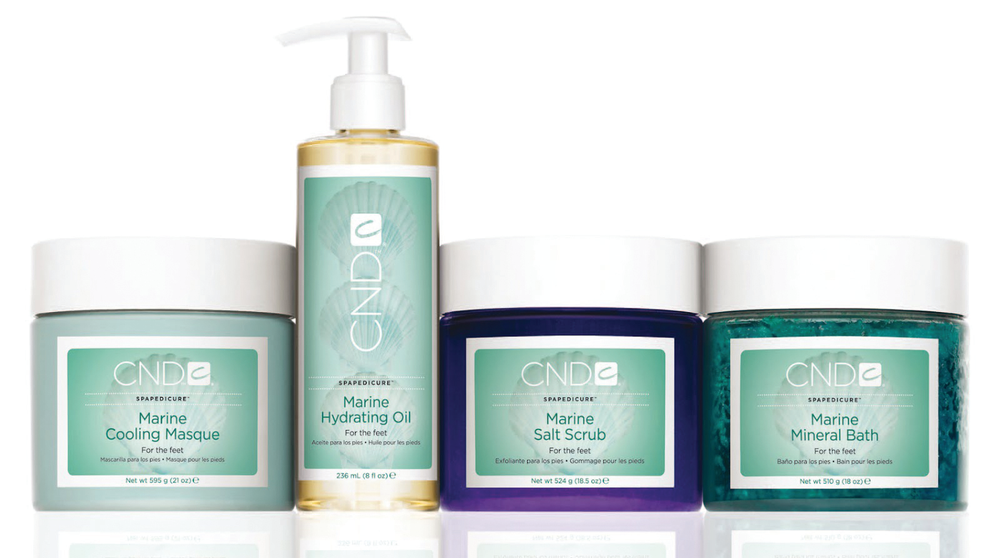 <p>CND's Marine SpaPedicure uses marine botanicals and sea salts to energize, cool, and rejuvenate tired feet. The line includes a Mineral Bath, Salt Scrub, Cooling Masque, and Hydrating Oil that are lightly fragranced to create an aquatic and relaxing sensation for clients. <br />www.cnd.com</p>