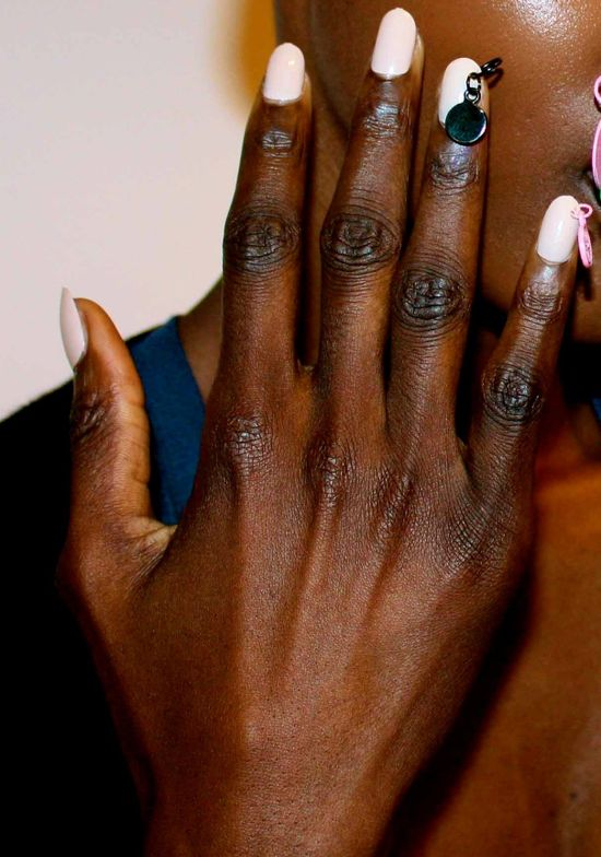 <p>At Ashish at London Fashion Week, Marian Newman for <strong>CND</strong>&nbsp;layered Shellac in Cocoa and Romantique for the perfect nude. The pinkie finger and ring finger were pierced with painted charms in black, fluorescent green, and pink that were sprayed by hand.<em> Photography courtesy of CND</em></p>