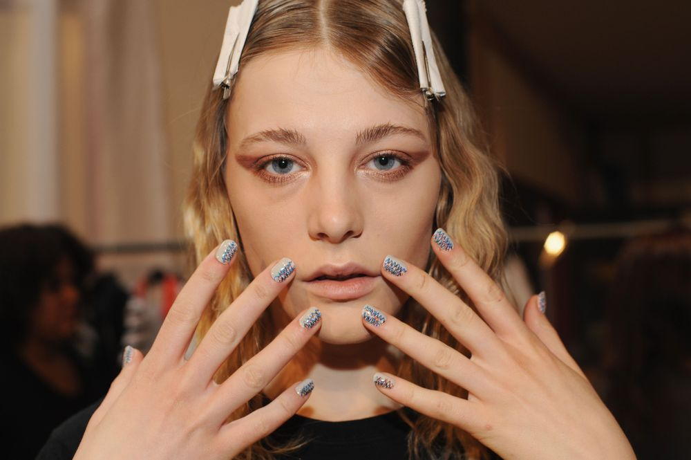 <p>NAIL ART: CND unveiled three graffiti styles at the Creatures of The Wind Fall 2013 RTW show. A quick trick: Use an Ultra Fine Point Sharpie to create the waves!</p>