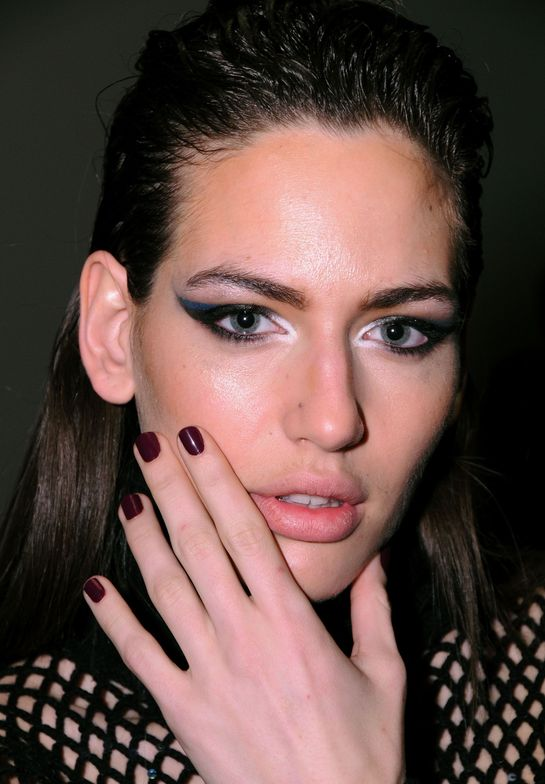 """<p class=""""TDP"""">At&nbsp;Malandrino, <strong>CND</strong>&rsquo;s&nbsp;Angi Wingle&nbsp;custom blended a strong plum cherry shade using&nbsp;CND Colours in Plumville&nbsp;and&nbsp;Dark Ruby&nbsp;and topped with two coats of high-shine&nbsp;CND Air Dry Top Coat&nbsp;for a biker chic manicure to match leather accents and tough girl graphic eyes. <em>Photography courtesy of CND</em></p>"""