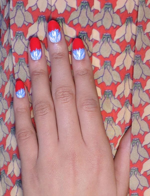 """<p class=""""TDP"""">At Rachel Antonoff, <strong>CND</strong>&rsquo;s Candice Manacchio created this floral design with two coats of bold red Flashpoint with hand-detailed ferns using Brilliant White<strong>&nbsp;</strong>and Anchor Blue. <em>Photography courtesy of CND</em></p>"""