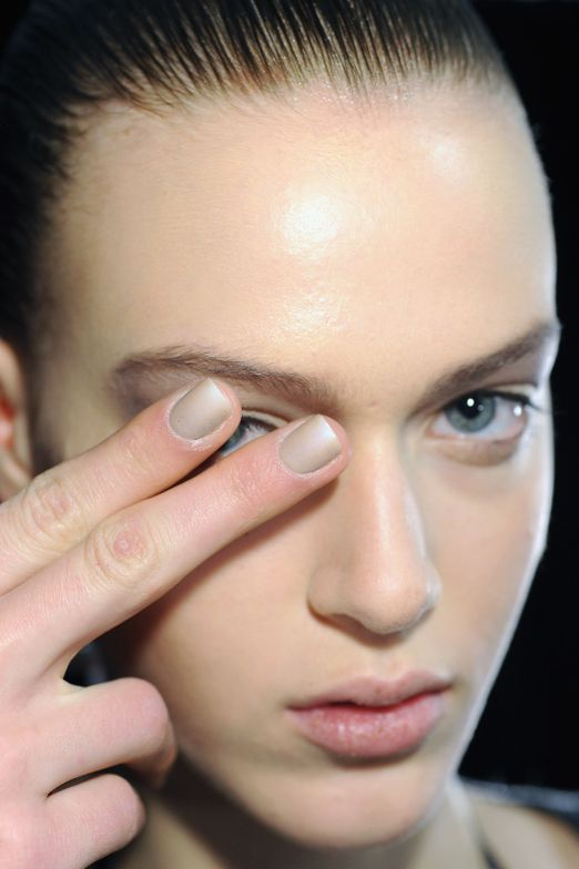 <p>NEUTRALS: CND created a time worn sand stone manicure for Alexander Wang using CND Colour in Impossibly Plush and feathering it with a fan brush from the sides toward the center. After sealing with CND Speedey Top Coat the shine was buffed with a CND Glossing Buffer giving the nail a natural eroded monochromatic look.</p>