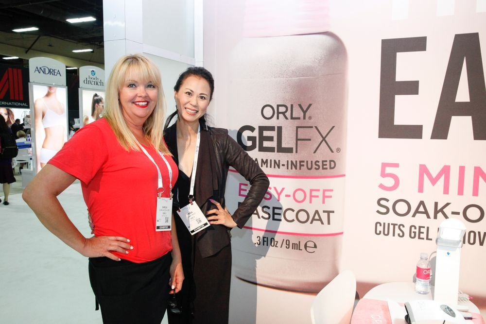 <p>Orly's Carla Collier (left) explained the benefits of GelFX Bodyguard for techs</p>